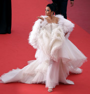 Aishwarya Rai floated onto the Cannes red carpet wearing a white tulle and feather confection by Ashi Studio Couture during the screening of 'La Belle Epoque.'