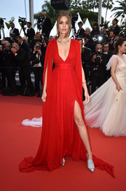 Josephine Skriver was sexy-glam in a plunging red gown by Pamella Roland at the 2019 Cannes Film Festival screening of 'La Belle Epoque.'