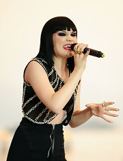 Jessie J rocked out on stage wearing a four finger ring in gold.