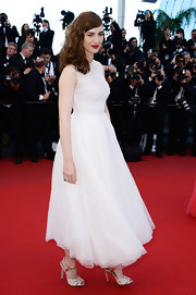 Louise Bourgoin chose a flowing white frock for her elegant and ethereal look at 'Le Passe' premiere.