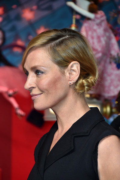 Uma Thurman styled her hair into a knotted side chignon at the Printemps Christmas decorations inauguration.