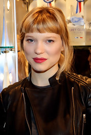 French actress Lea Seydoux amplified her natural look with saturated red lips.