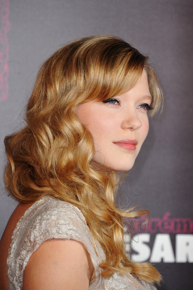 Lea Seydoux Long Curls with Bangs [hair,hairstyle,blond,chin,hair coloring,long hair,brown hair,eyebrow,layered hair,bangs,lea seydoux,cesar,red carpet arrivals - cesar film awards,french,paris,france,theatre du chatelet,film awards ceremony]