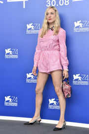 Chloe Sevigny coordinated her romper with a pair of black kitten heels with gingham slingback straps.