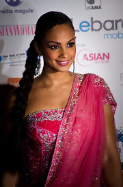 Alesha Dixon wore her long brunette locks braided on the side. A tight braid accented her alluring look.