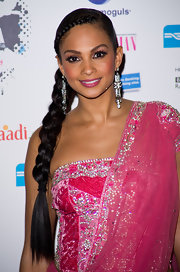 Alesha paired her sleek braided 'do with large statement earrings.