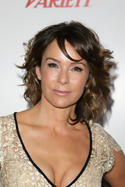 Jennifer Grey topped off her sweet look with a very feminine short curly 'do when she attended the Dare2Care pre-Oscar party.