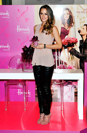 Leighton Meester launched the new Vera Wang fragrance in style in a pair of strappy mauve Rina sandals.