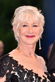Helen Mirren completed her look with a pair of dangling spheres by Chopard.