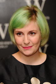 Lena Dunham's pink lipstick provided a nice contrast to her green hair.