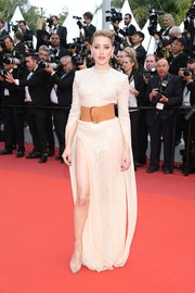 Amber Heard showed off her leg in a nude Claes Iversen Couture sequin gown with a hip-high slit at the 2019 Cannes Film Festival screening of 'Les Miserables.'
