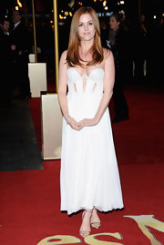 Isla Fisher showed some skin in this teeny corset dress with sexy cutouts at the 'Les Miserables' world premiere.