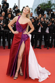 Toni Garrn looked vibrant in a tricolor one-shoulder ballgown by Ralph & Russo Couture at the 2019 Cannes Film Festival screening of 'Les Plus Belles Années d'une vie.'