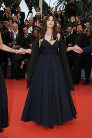 Monica Bellucci chose a midnight-blue fit-and-flare gown by Dior at the 2019 Cannes Film Festival screening of 'Les Plus Belles Années d'une vie.'