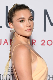Florence Pugh wore her hair in a classic braid at the Paris premiere of 'Little Women.'