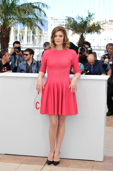 Chiara Mastroianni opted for a bright and cheerful summertime frock when she wore this pink three quarter-length dress with a stylish pleated skirt.