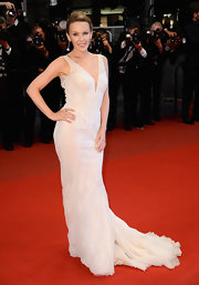 Kylie Minogue chose an elegant flowing dress with a plunging neckline for her look at the Cannes Film Festival.