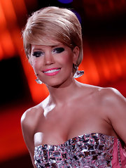 Sylvie van der Vaart flashed her million dollar smile with bright bubble gum pink lipstick.