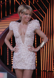 Sylvie van der Vaart stunned in a cream  cocktail dress with elaborate pearl embroidery by Jan Taminiau.