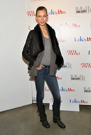 Karlie kept comfy in a shawl jacket paired with black leather boots.