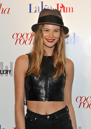 Behati Prinsloo topped off her look at the 'Letters to Haiti' premiere with a brown fedora.