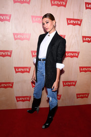Hailey Baldwin styled her outfit with a pair of black cowboy boots by Givenchy.