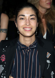 Caroline Issa accessorized with a pair of sterling dangle earrings at the Libertine Spring 2016 show.