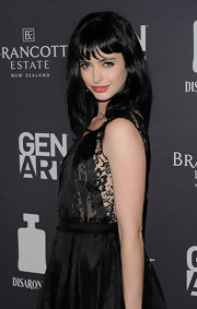 Krysten Ritter styled her ultra dark locks in a straight and shiny 'do.