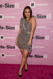 A pair of black pumps with bedazzled ankle straps completed Francia Raisa's look.