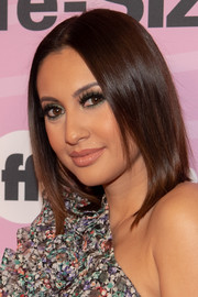 Francia Raisa sported a straight center-parted hairstyle at the world premiere of 'Life-Size 2.'