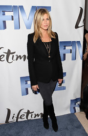 Jen topped off her red carpet ensemble with black suede knee-high boots.