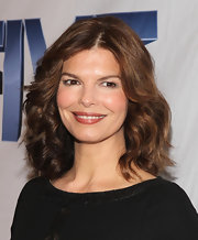 At a screening for the tv movie 'Five' Jeanne Tripplehorn wore her chestnut tresses in a simple, wavy 'do. To try her look, add a product like Bumble and Bumble Curl Conscious Defining Creme to damp hair to help define and condition natural waves and curls.