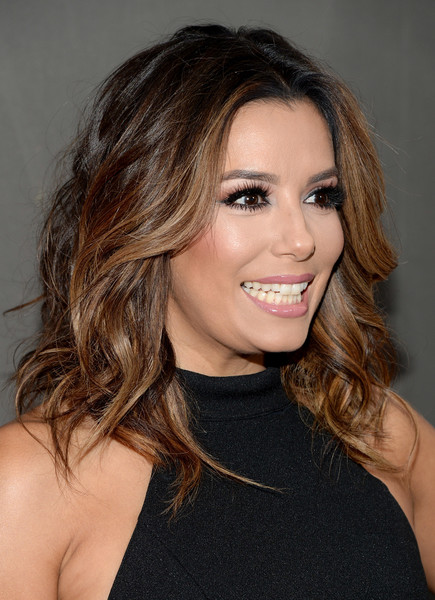 Eva Longoria finished off her look with a glossy pink lip.