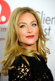 Elisabeth Rohm arrived at the launch party for 'The Client List' wearing her hair in long slightly waved layers.