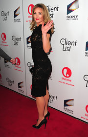 Elisabeth Rohm arrived at the launch of 'The Client List' wearing a pair of sparkly black pumps.