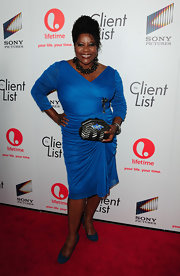 Loretta Devine carried this unique clutch to the launch party of 'The Client List.'