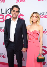 Rose Byrne paired a green and gold satin purse with a strapless pink dress for the world premiere of 'Like a Boss.'