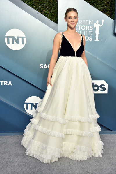 Lili Reinhart Empire Gown [dress,clothing,gown,shoulder,fashion model,carpet,fashion,a-line,hairstyle,flooring,arrivals,lili reinhart,screen actors guild awards,screen actors\u00e2 guild awards,the shrine auditorium,los angeles,california,jennifer aniston,screen actors guild awards,sag-aftra,actor,red carpet,celebrity,fashion,screen actors guild award for outstanding performance by a female actor in a leading role,academy awards]