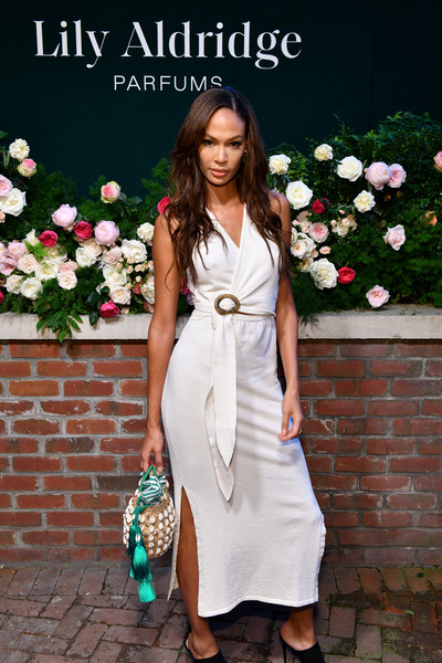 More Pics of Joan Smalls Straw Tote (3 of 12) - Tote Bags Lookbook - StyleBistro [photo,clothing,white,dress,fashion model,shoulder,lady,fashion,formal wear,footwear,street fashion,joan smalls,lily aldridge,the bowery terrace,new york city,bowery hotel,lily aldridge parfums launch event,launch event]