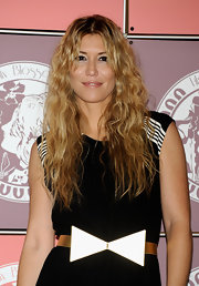 Raquel Merono showed off her long curls while hitting the a launch party in Madrid.
