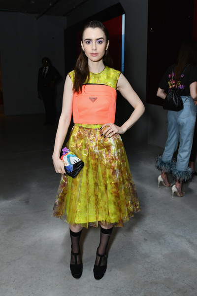 Lily Collins Printed Clutch [clothing,fashion model,fashion,yellow,fashion design,fashion show,abdomen,event,footwear,dress,arrivals,lily collins,front row,new york city,prada resort 2019 fashion show,fashion show]