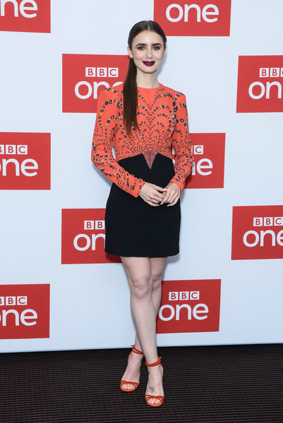 Lily Collins Print Dress [les miserables,clothing,carpet,fashion,dress,cocktail dress,shoulder,red carpet,joint,flooring,premiere,lily collins,photocall,photocall,england,london,bbc one,bafta]