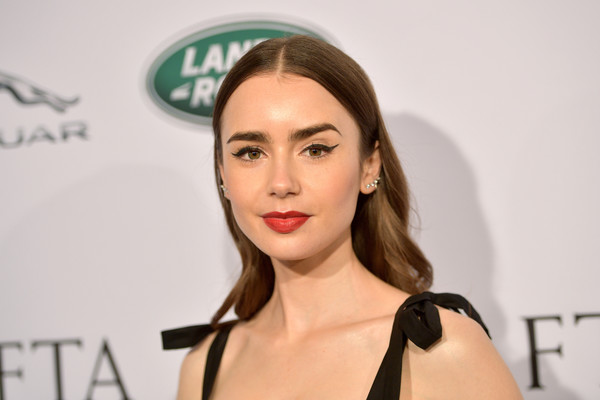 Lily Collins Long Wavy Cut [hair,face,eyebrow,lip,skin,hairstyle,beauty,cheek,shoulder,chin,arrivals,lily collins,los angeles,four seasons hotel,california,beverly hills,bafta,tea party]