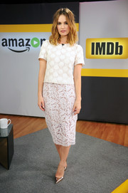 Lily James teamed her top with a white lace pencil skirt in a contrasting pattern (also by Galvan).