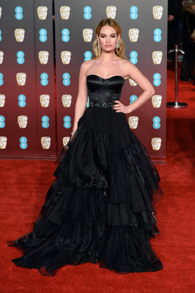 Lily James Corset Dress [gown,flooring,dress,carpet,beauty,lady,red carpet,fashion model,shoulder,formal wear,red carpet arrivals,lily james,ee,england,london,royal albert hall,british academy film awards,lily james,71st british academy film awards,royal albert hall,british academy film awards,british academy of film and television arts,british academy television awards,red carpet,actor,times up]