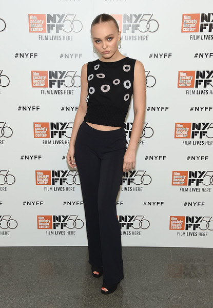 Lily-Rose Depp Knit Top [clothing,shoulder,fashion,crop top,waist,carpet,joint,footwear,red carpet,flooring,a faithful man,lily-rose depp,screening,lincoln center,new york city,alice tully hall,new york film festival]