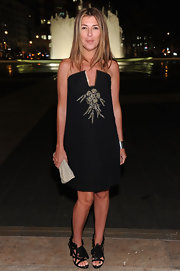 Nina Garcia looked ultra chic at the Ralph Lauren soiree in NYC. She paired her black strapless dress with black floral-adorned strappy heels.