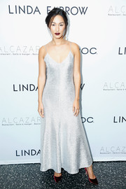 Nicole Warne was an elegant standout in an ankle-length silver slip dress at the Linda Farrow Paris Fashion Week dinner.