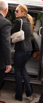 While making yet another appearance in court, Lindsay Lohan showed off a tweed embellished shoulder bag.