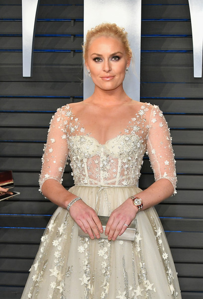Lindsey Vonn Metallic Clutch [oscar party,vanity fair,clothing,dress,hair,gown,haute couture,lady,fashion,shoulder,wedding dress,hairstyle,beverly hills,california,wallis annenberg center for the performing arts,radhika jones - arrivals,radhika jones,lindsey vonn]